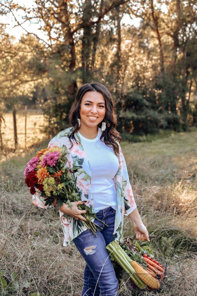 Daisy Gomez holding flowers