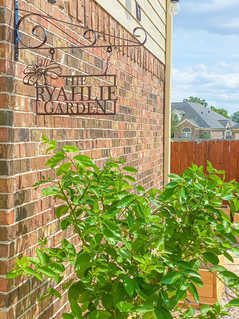 the ryahlie garden iron sign